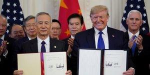 Donald Trump, aux côtés du vice-Premier ministre de la Chine, Liu He, après la signature de la phase 1 de l'accord Chine-Etats-Unis